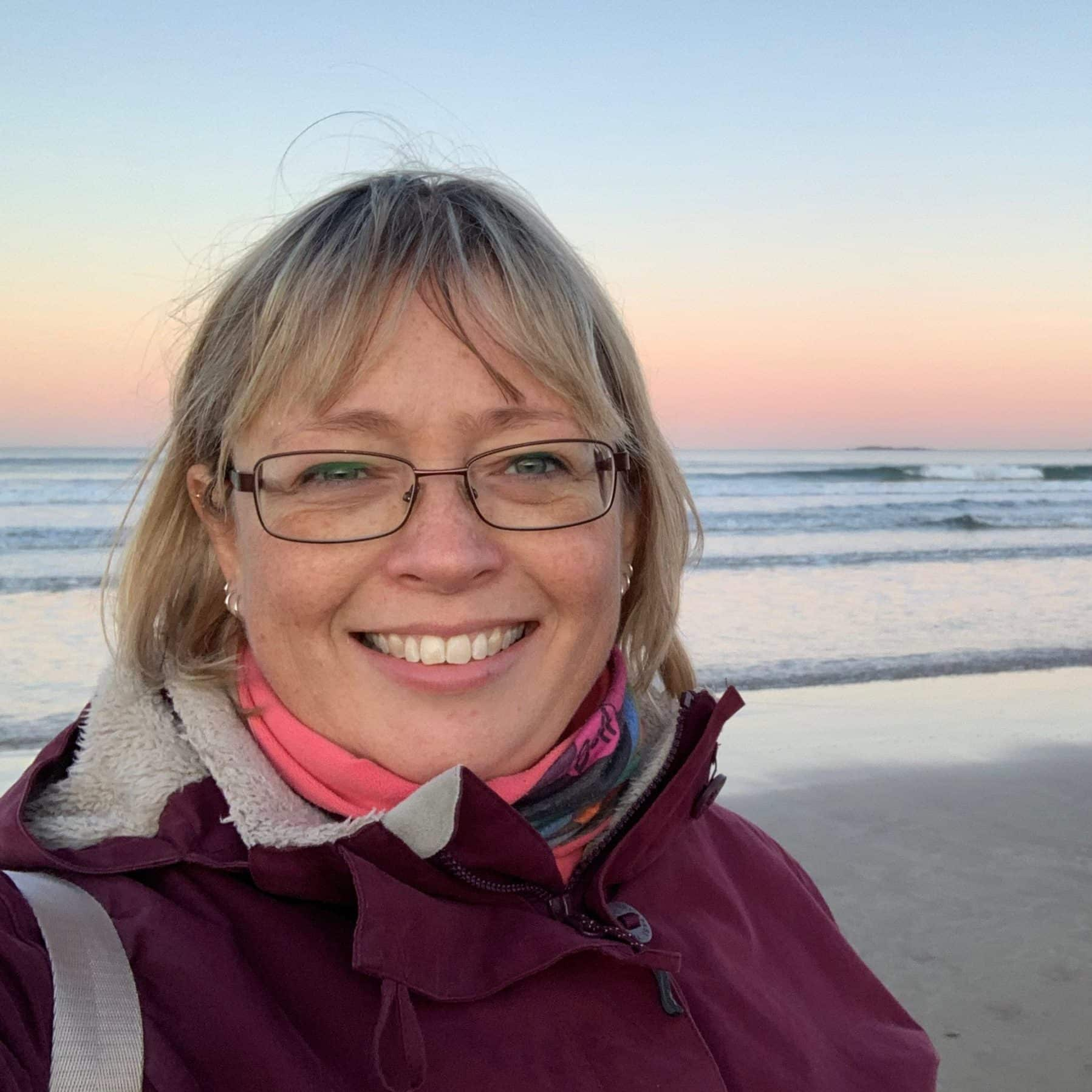 woman on cold beach at sunset